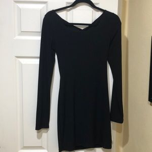 Classy long-sleeved black dress with peep back